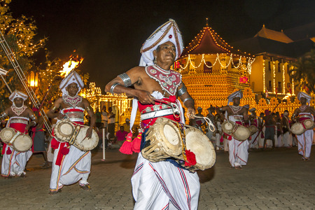 Thammattam Players perform at the Esala Perahara, Kandy, Sri Lanka. The drum is tied around the performers waist to allow free movement of the hands and feet whilst dancing and drumming.The Esala Perahera is held to honour the Sacred Tooth Relic of Lord B Editorial