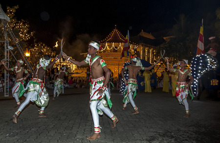rains: Paddy Dancers or Goyan Netuma  perform during the Esala Perahera in Kandy, Sri Lanka. The Paddy Dance represents the harvesting of the crop with sickles and showcases the pride of prosperity received when timely rains occur. The dance is accompanied by a