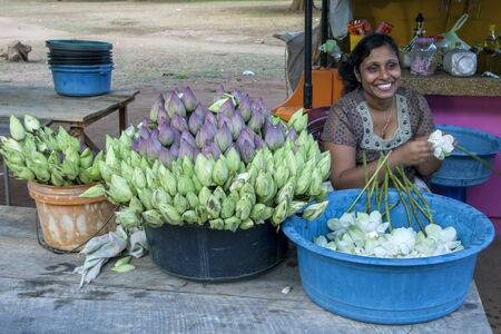 southern sri lanka: A lady selling flowers outside the Kataragama Temple in southern Sri Lanka. Editorial