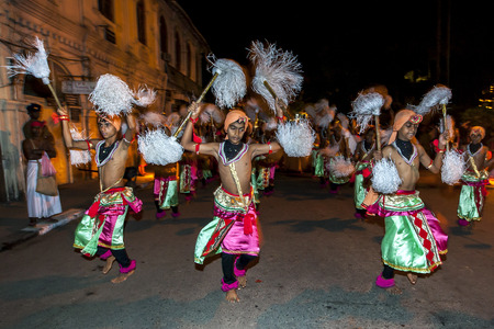 lord buddha: Chamara Dancers prepare to perform in the Esala Perahara in Kandy, Sri Lanka. The Esala Perahera takes place every July or August and is held to honour the sacred tooth relic of Lord Buddha which is held within the Temple of the Sacred Tooth Relic in Kand