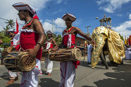ceremonial: Gatabera Players Getaberakaruwo perform ahead of a ceremonial elephant at the Hikkaduwa Perahera on the east coast of Sri Lanka.