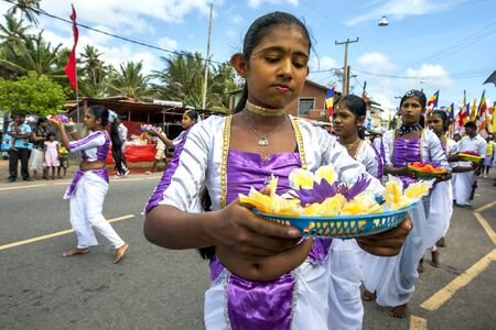buddha sri lanka: Colourful dancers with offerings to Lord Buddha participating in the Hikkaduwa perahera on the east coast of Sri Lanka.