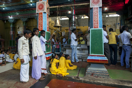 puja: Hindu boys ringing a ceremonial bell during Puja prayers at Koneswaram Kovil in Trincomalee on the east coast of SriLanka.