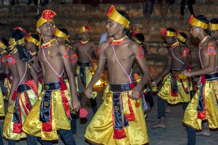 cymbal: Cymbal Players or Thalampotakaruwo perform along the streets of Kandy during the Esala Perahara in Sri Lanka. Editorial