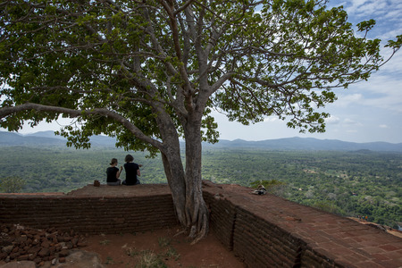 sigiriya: Tourists and a dog enjoy the view from the summit of Sigiriya Rock in Sigiriya, Sri Lanka.