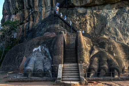 lions rock: The final climb to the summit of Sigiriya Rock passes through the enormous Lions Paws of what was once a mighty lions statue carved from rock. Editorial