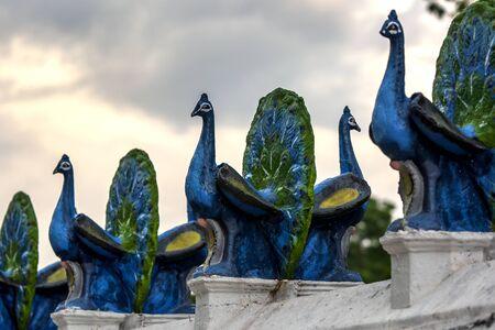southern sri lanka: A line of peacock statues line the main courtyard at the Kataragama temple in southern Sri Lanka near Tissamaharama. Stock Photo