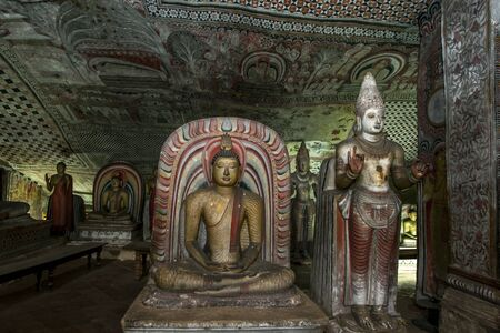 buddha sri lanka: Colourful Buddha statues in one of the caves at Dambulla Cave Temples in Sri Lanka.
