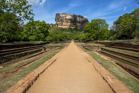 sigiriya: A view from the Royal Gardens from the western entrance looking towards Sigiriya Rock in Sri Lanka. The gardens were constructed during the reign of King Kassapa between AD 477 and 485.