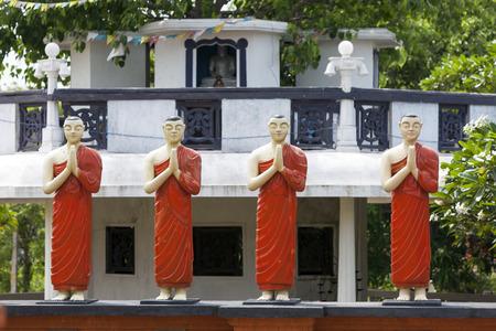 sigiriya: A row of statues at the Pidurangala Buddhist Temple in Sigiriya, Sri Lanka.