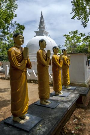 sigiriya: Buddhist monk statues stand near a stupa at the Pidurangala Buddhist Temple in Sigiriya, Sri Lanka.