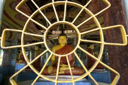sigiriya: Buddhist statues within an Image House at the Pidurangala Buddhist Temple in Sigiriya, Sri Lanka.