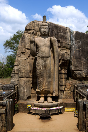 The Aukana Buddha statue located at Aukana Raja Maha Viharaya in Sri Lanka. The statue is considered to be the finest example of such stone carving in Asia.