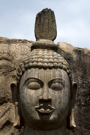 aukana buddha: The Aukana Buddha statue located at Aukana Raja Maha Viharaya in Sri Lanka. The statue is considered to be the finest example of such stone carving in Asia.