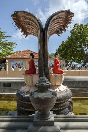 vihara: The beautiful cobra fountain at the Buddhist Nagadipa Vihara on Nainativu Island in the Jaffna region of Sri Lanka.