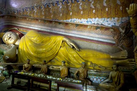 The Laying Buddha stutue in the Image House at Wewurukannala Vihara at Dickwella in Sri Lanka. Editorial