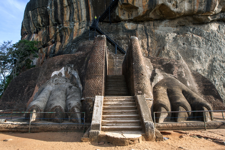 lions rock: The enormous lions paws are all that remains of the former entrance to the Rock Fortress of King Kasyapaa 479 to 497 AD at Sigiriya, Sri Lanka. Editorial
