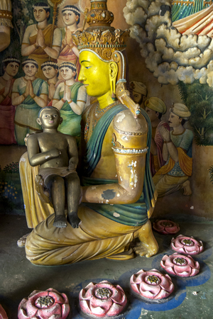lord buddha: The baby Lord Buddha being cradled by his mother centre in a display located in the main Image House at Wewurukannala Vihara near Dickwella on the south coast of Sri Lanka.