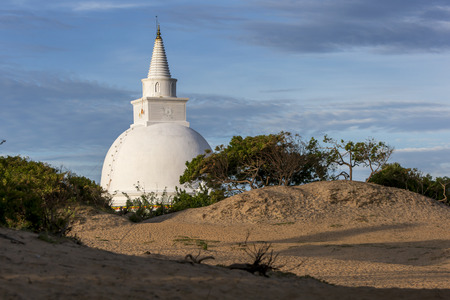 sandhills: The recently completed stupa sits amongst the sandhills near the ancient site of Mudu Maha Vihara near Pottuvil on the east coast of Sri Lanka. Stock Photo