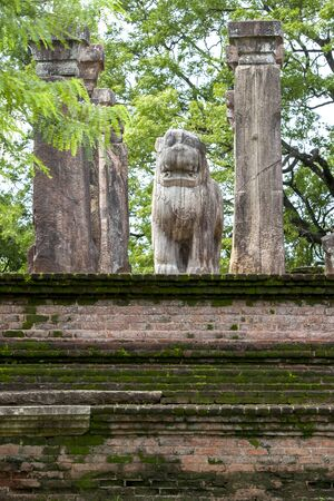 11th: The stone carved Lion statue at the former Council Chamber in the Island Garden at Polonnaruwa in Sri Lanka. Polonnaruwa was the centerpiece of the Sinhalese kingdom established by King Vijayabahu l in the 11th century. Stock Photo