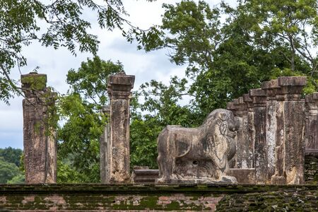 11th century: The stone carved Lion statue at the former Council Chamber in the Island Garden at Polonnaruwa in Sri Lanka. Polonnaruwa was the centerpiece of the Sinhalese kingdom established by King Vijayabahu l in the 11th century. Stock Photo