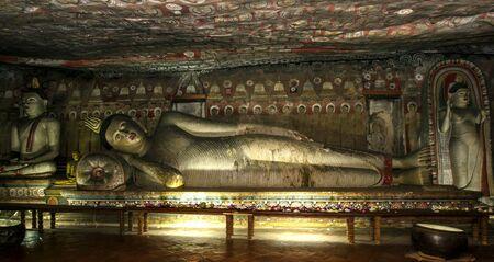maharaja: A giant lying Buddha statue in Cave Two Maharaja Viharaya at the Dambulla Cave Temples. Stock Photo