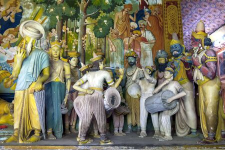 A colourful display of life like figures including musicians and drummers in the main Image House at Wewurukannala Vihara near Dickwella on the south coast of Sri Lanka. Editorial