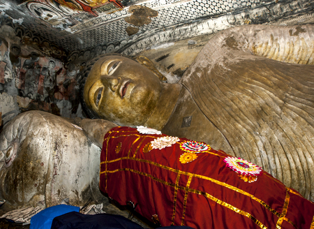 buddha sri lanka: The 14 metre long reclining Buddha statue inside Cave One Devaraja Viharaya at the Dambulla Cave Temples at Dambulla in central Sri Lanka.