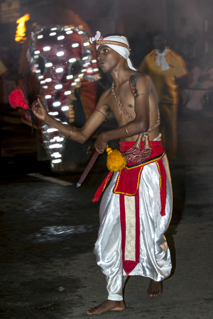 tapper: A Wood Tapper performs during the Esala Perahera in Kandy, Sri Lanka. Wood Tappers perform a quick step dance which includes running and jumping designed to display ancient warriors in battle.The Esala Perahera is held to honour the Sacred Tooth Relic of
