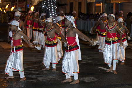 cymbal: Cymbal players perform through the streets of Kandy during the Esala Perahera. The Esala Perahera runs every year in late July or early August for ten days, ending on the Nikini poya full moon and is held to honour the Sacred Tooth Relic of Lord Buddha wh Editorial