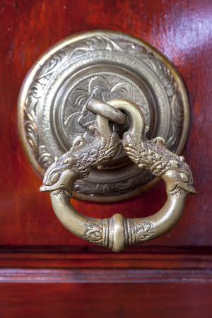 kandy: A beautifully crafted door latch at Bahiravakanda Temple which sits atop a hill overlooking the city of Kandy in central Sri Lanka. Stock Photo