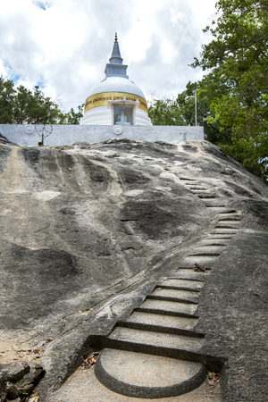 dagoba: A stone cut stairway leads to the dagoba at the ancient site of Madya Mandalaya which is located around 20 kilometres from Panama on the east coast of Sri Lanka. This site is significant in that King Kawan Tissa BC 210-161 established the Hermitage of Kud