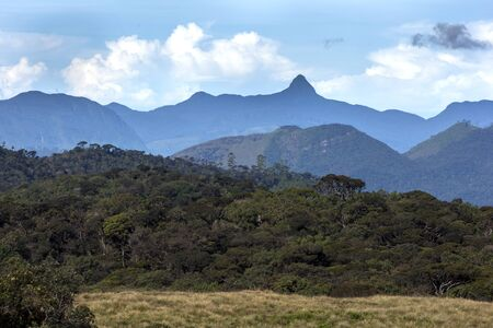 adams: A beautiful view showing the spectacular mountain range seen from near Horton Plains National Park. The highest point is the famous Adams Peak with a height of 2,243 metres 7,359 feet. At the summit is an imprint in the rock which Buddhist followers beli Stock Photo