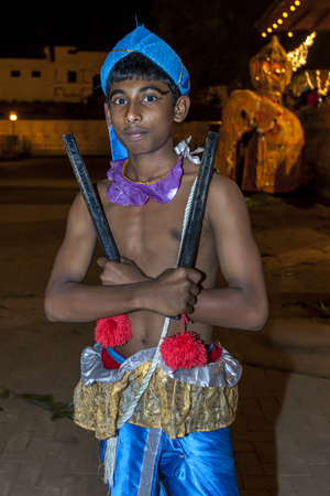 tapper: A Wood Tapper ready to perform at the Esala Perahara in Kandy, Sri Lanka. Wood Tappers perform a dance which includes running and jumping whilst tapping to recall ancient warriors in battle.