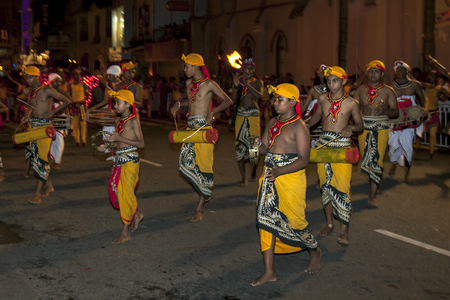 lord buddha: Young musicians perform along the streets of Kandy in Sri Lanka during the Esala Perahera. The Esala Perahera is held to honour the Sacred Tooth Relic of Lord Buddha which is enshrined within the Temple of the Sacred Tooth Relic and is considered one of t Editorial