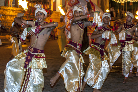 lord buddha: Dance of Beetle Bulath Padhaya dancers perform along the streets of Kandy during the Esala Perahera in Sri Lanka. The Esala Perahera is held to honour the Sacred Tooth Relic of Lord Buddha which is enshrined within the Temple of the Sacred Tooth Relic and