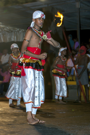 cymbal: Cymbal Players Thalampotakaruwo perform along the streets of Kandy during the Esala Perahra in Sri Lanka. The Esala Perahera runs every year in late July or early August for ten days, ending on the Nikini poya full moon and is held to honour the Sacred To