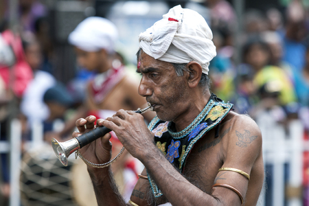 trumpet player: A Trumpet Player performs along the streets of Kandy during the daytime Perahera in Kandy, Sri Lanka. The Esala Perahera is held to honour the Sacred Tooth Relic of Lord Buddha which is enshrined within the Temple of the Sacred Tooth Relic and is consider