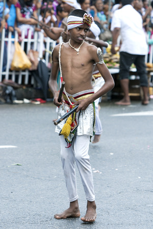 tapper: A Wood Tapper performs during the day Perahera in Kandy, Sri Lanka. The Esala Perahera is held to honour the Sacred Tooth Relic of Lord Buddha which is enshrined within the Temple of the Sacred Tooth Relic and is considered one of the most colourful proce
