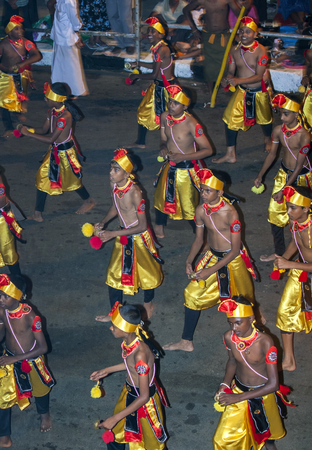 cymbal: A group of Cymbal Players Thalampotakaruwo performs along the streets of Kandy during the Esala Perahera. The Esala Perahera festival runs every year in late July or early August for ten days, ending on the Nikini poya full moon and is held to honour the  Editorial