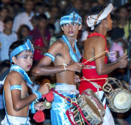 cymbal: A Cymbal Player, a Thammattam Player and a Gatabera Player perform during the Esala Perahara in Kandy in Sri Lanka. The Esala Perahera runs every year in late July or early August for ten days, ending on the Nikini poya full moon and is held to honour the