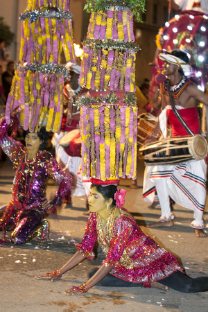 kandy: Dancers perform to the beat of drummers along the streets of Kandy during the Esala Perahera in Sri Lanka.