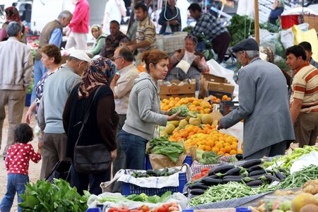 renowned: A crowd gathers at the weekly Friday market in Kas, Turkey. Kas is renowned for its quality fruit and vegetables and is located on the Turkish Mediterranean.