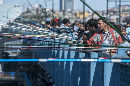 eminonu: Hundreds of fishermen with their rods set up on Galata Bridge in Eminonu in Istanbul in Turkey. They are hoping to catch fish from Golden Horn, an artery of the Bosphorus. Editorial