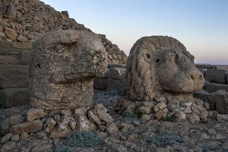 metres: Sitting on the eastern platform of Mt Nemrut are the statues of an eagle and a lion. The Mt Nemrut National Park is situated in the Anti-Taurus mountain range 2150 metres in Turkey between Malatya to the north and Kahta to the south. Stock Photo
