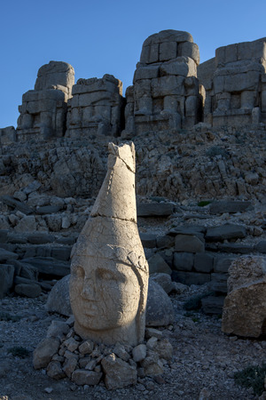 metres: The last rays of sunshine hit the statue of Antichos on the eastern platform at Mt Nemrut. The Mt Nemrut National Park is situated in the Anti-Taurus mountain range 2150 metres in Turkey between Malatya to the north and Kahta to the south.