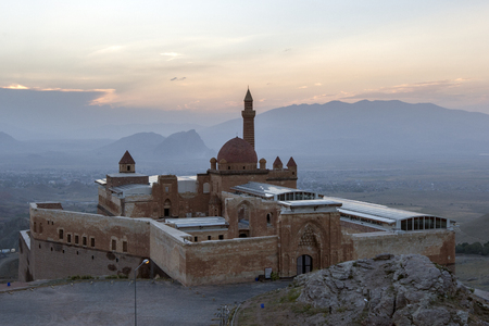 The magnificent Ishak Pasa Palace in the late afternoon. Constuction of the palace was begun in 1685 by Colak Abdi Pasa, but was not completed until 1784 by his son Ishak. In the background is the town of Dogubayazit which lies on the Turkish eastern bord