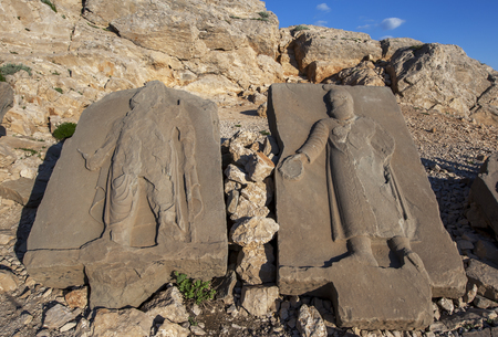 metres: Sandstone Steles on the western platform at Mt Nemrut, Turkey. These steles were placed over the graves of deceased people in ancient times. The Mt Nemrut National Park is situated in the Turkish Anti-Taurus mountain range 2150 metres in Turkey between Ma