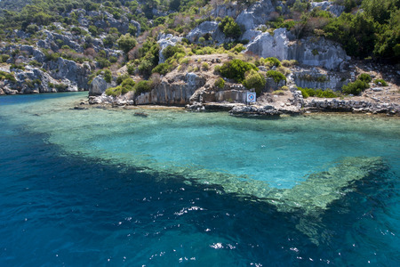 earthquakes: A section of the Sunken City showing Byzantine ruins on Kekova Island in the Turkish Mediterranean Sea. The city sunk into the sea after a series of earthquakes in the 2nd century AD. Stock Photo