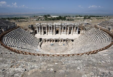 exceeding: The spectacular Roman Theatre at Hierapolis. It had a seating capacity exceeding 12,000 and was built in two stages by the emperors Hadrian and Septimius Severus.
